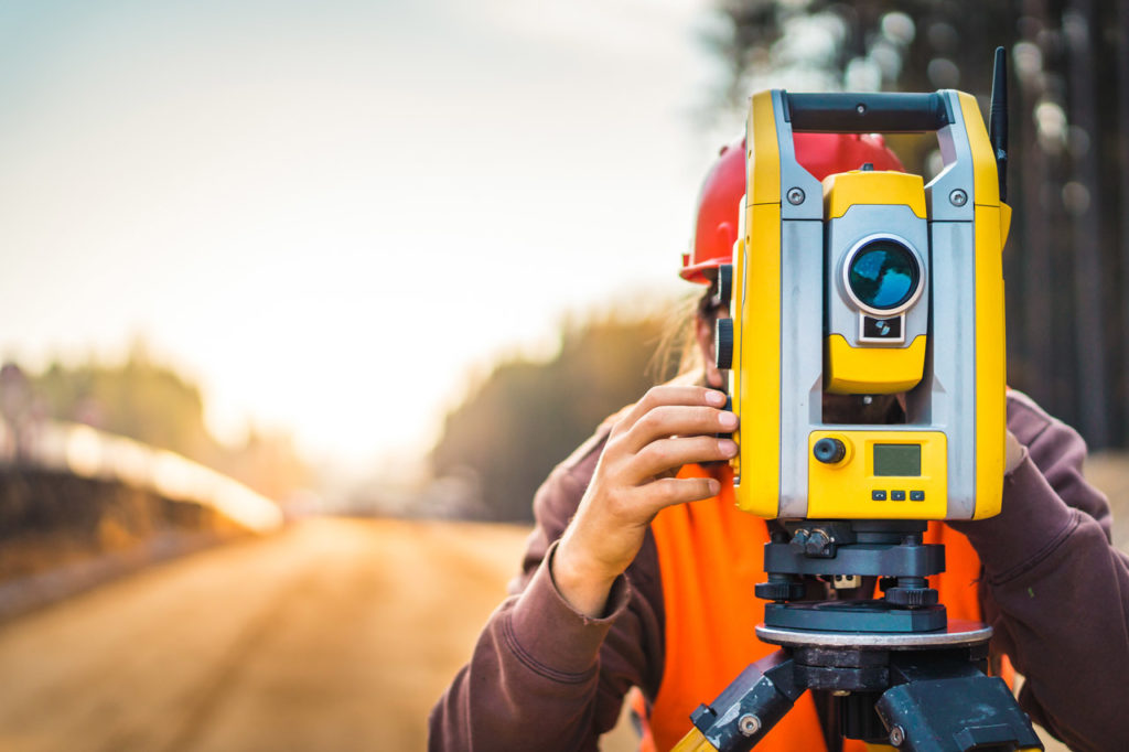Surveyor engineer with equipment (theodolite or total positionin